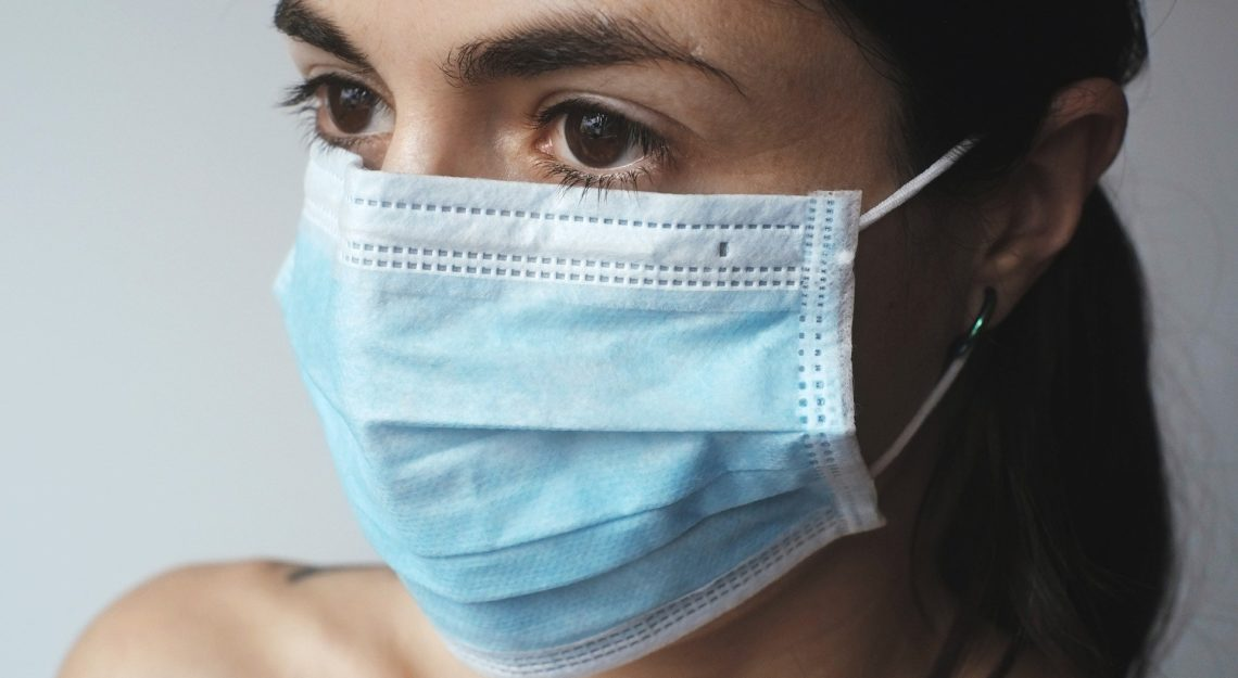 A woman in a surgical mask
